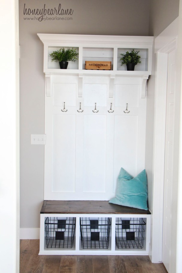 Wooden coat rack with bench and storage shelves