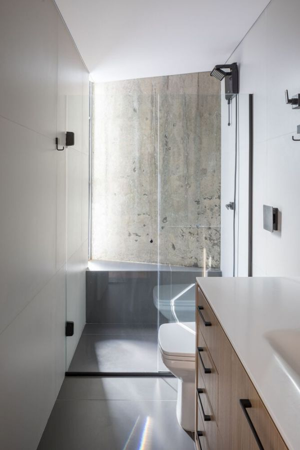 Even the bathroom has its own concrete wall which is beautifully highlighted by the window
