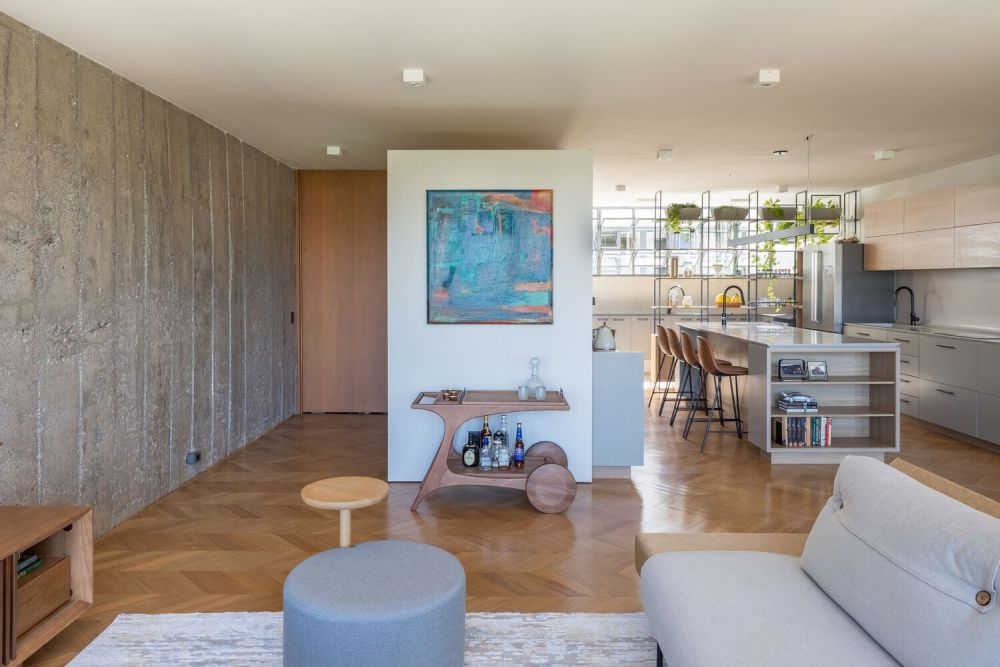 The wooden floor unifies the entire floor plan and offers a sense of continuity and comfort