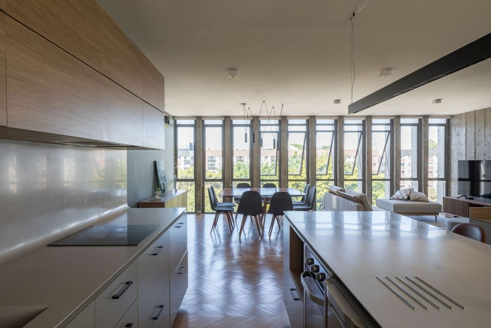 By opening up the floor plan spaces like the kitchen get to enjoy plenty of natural sunlight