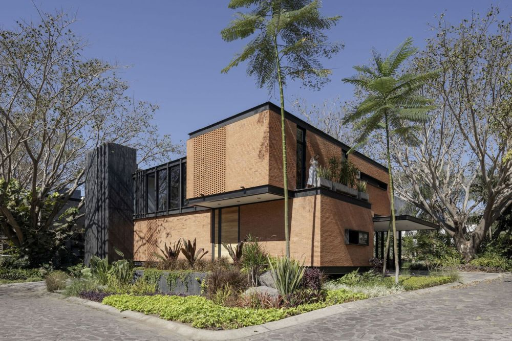 The perforations in the facade adds an interesting and also subtle texture to the exterior design