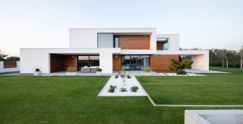 Minimalistic House In Poland With Recessed Windows And A Perfect Lawn