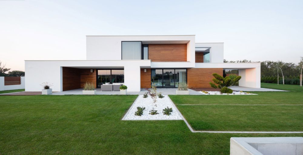 The house is positioned centrally on the site which gives it lots of open spaces around it