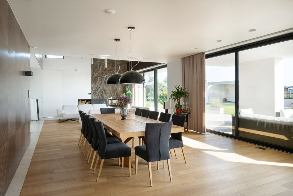 The dining room features a warm wooden floor and wooden furniture which make it feel very welcoming