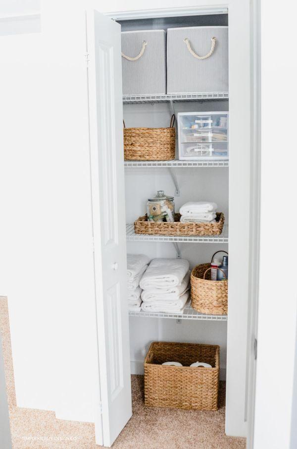 Linen closet makeover featuring baskets