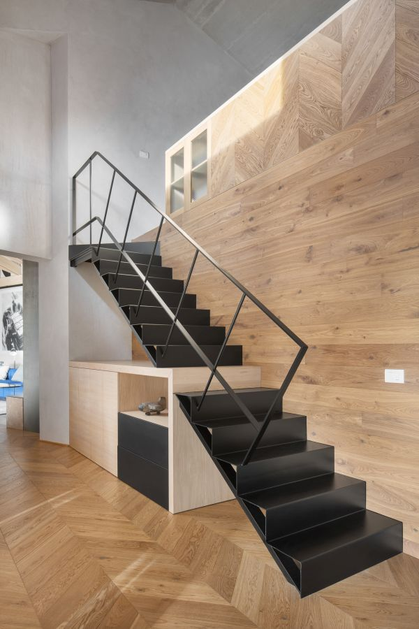 A unique staircase and furniture duo