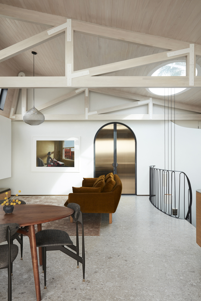 The skylights and the light-colored timber ceiling give the upper floor a very airy aesthetic