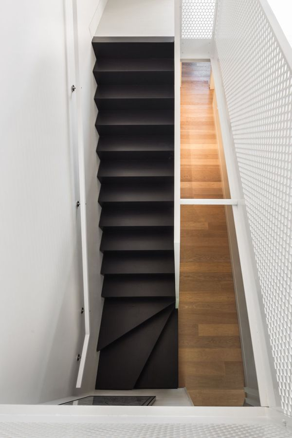 Black stairs with white railings