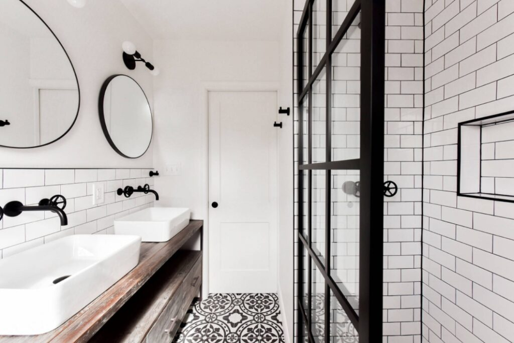 Black faucet and accents on Eclectic Industrial Bathroom Remodel