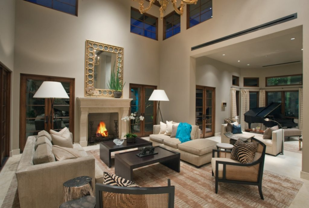 Living room with high ceiling and beige walls