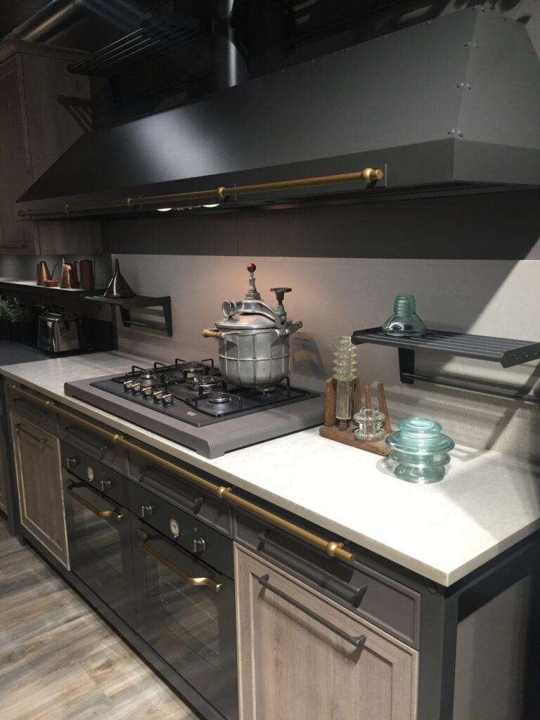 Black kitchen design with brass hardware