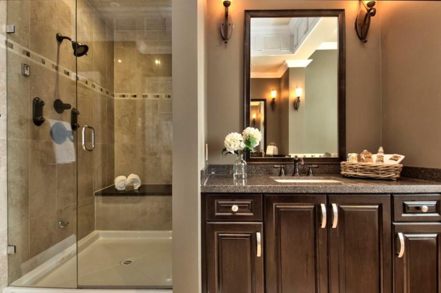 A tiled shower with an elegant trim