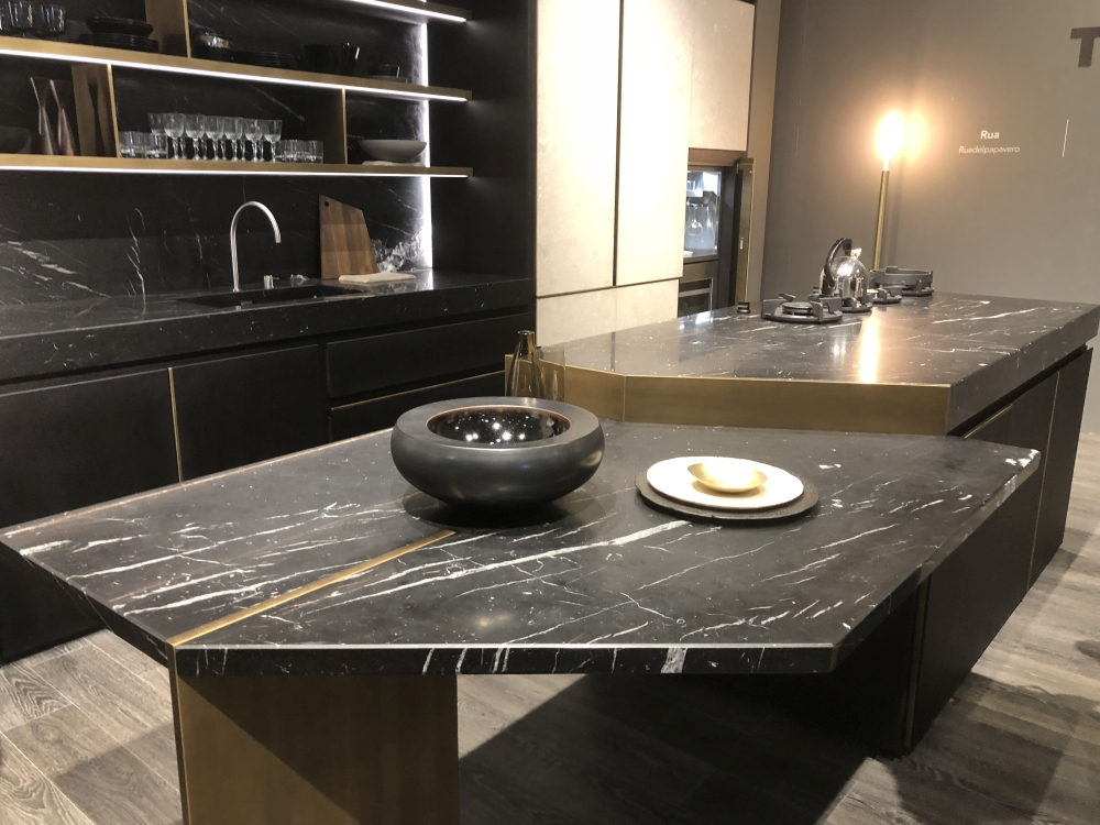 Modern kitchen layout with marble countertops and island