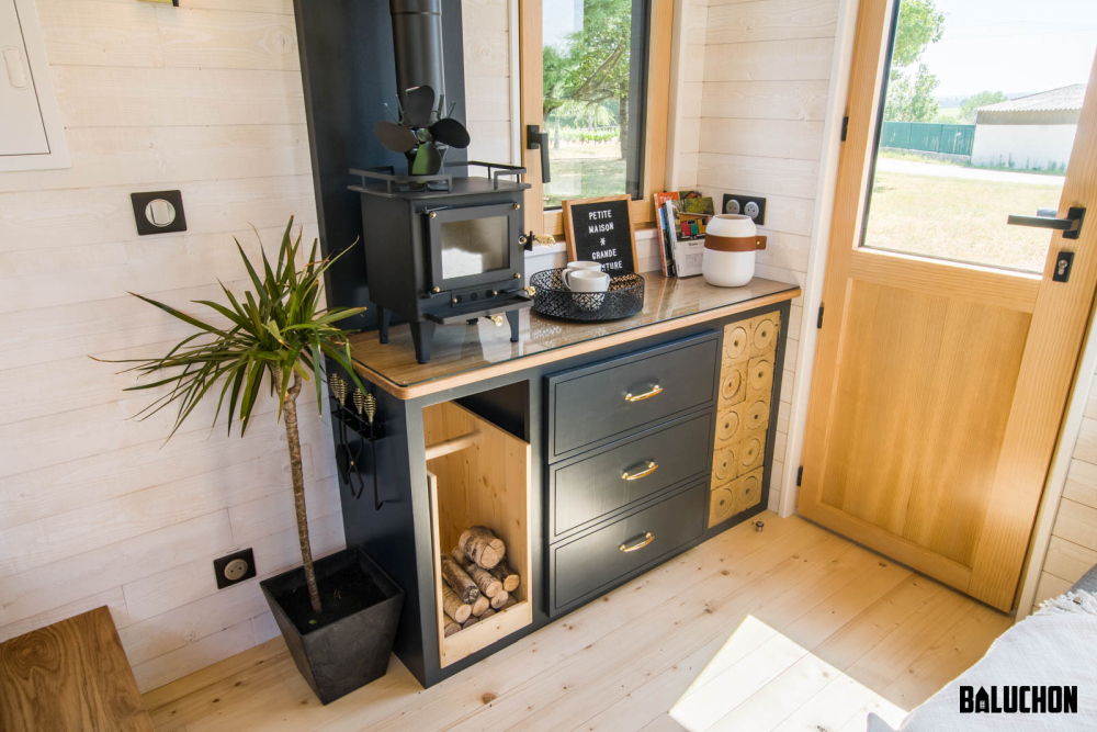 A little wood-burning stove makes this little house feel warm and cozy all year round