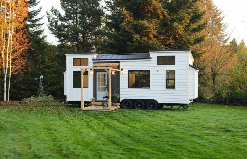 A Modern Tiny House With Board and Batten Siding And a Charming Front Porch