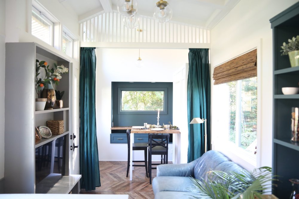 This side of the house has a cozy window nook and functions as a dining area during the day