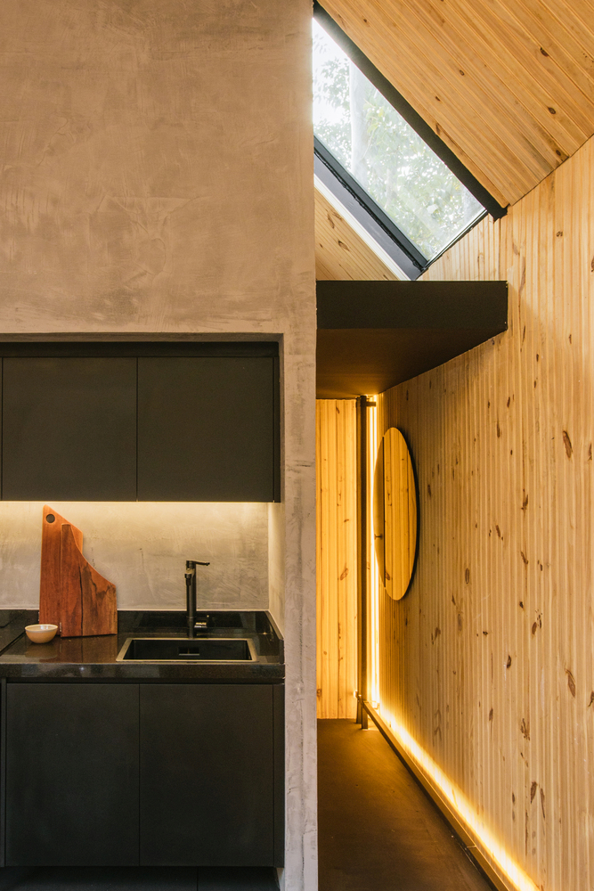LED light strips are installed along the walls, creating a chic and cozy vibe inside the cabin