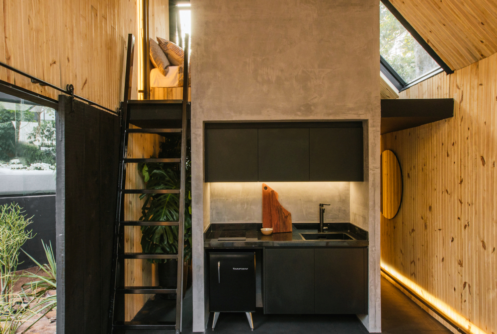 The loft area houses the bedroom and can be accessed via a ladder