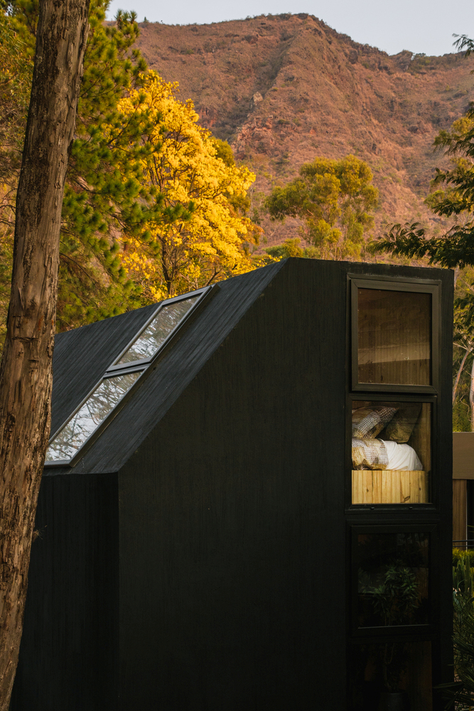 The roof slope features built-in windows which let light into the top section of the cabin