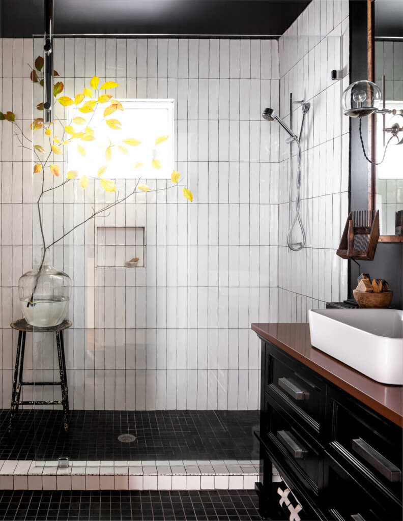 Bathroom with white vertical tiles and shower niche