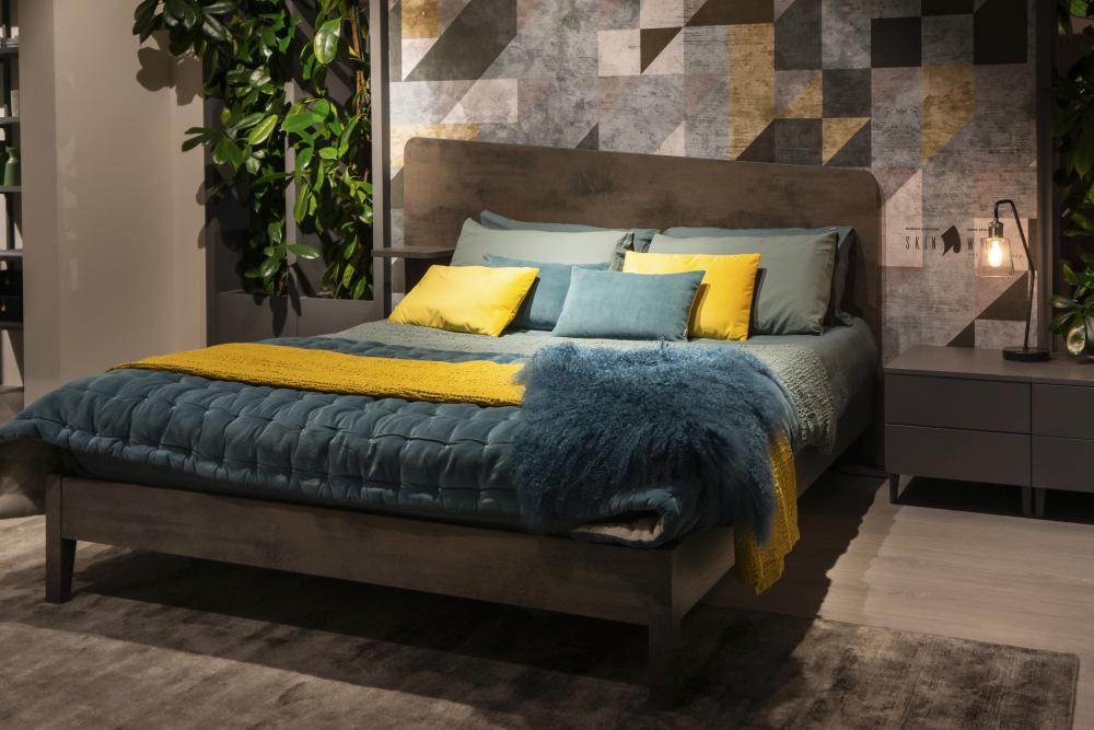 An asymmetrical couple's bedroom