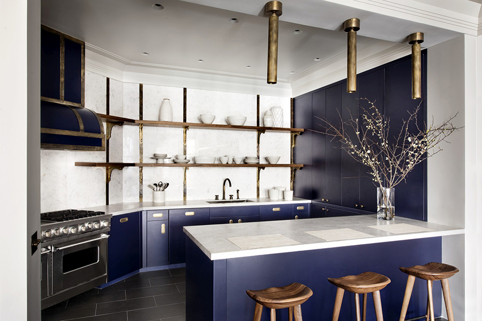 Blue shade kitchen cabinets with brass hardware