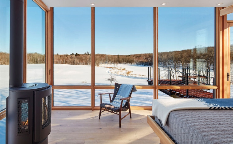 The bedrooms opens onto the elevated deck and has a panoramic view towards the lake