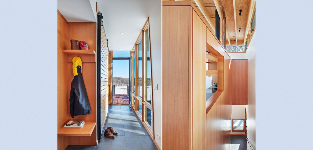The interior is divided into two floors connected by a wooden staircase
