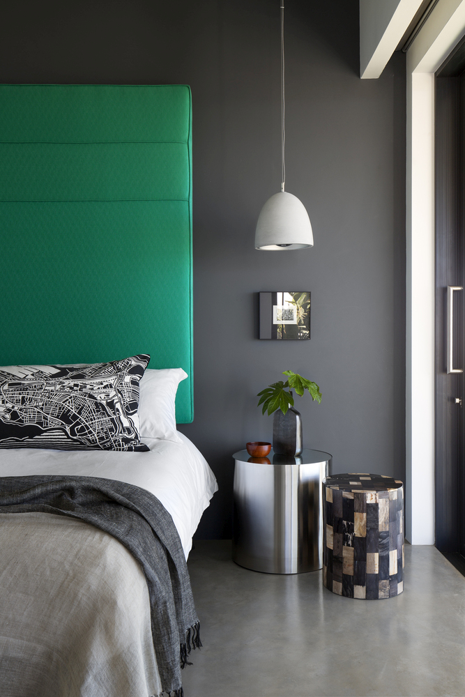 This Jade green headboard adds a stylish splash of color to the bedroom