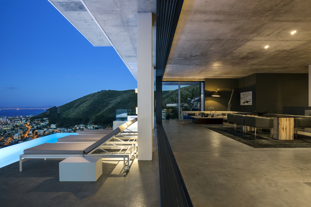 The polished concrete floor makes the indoor-outdoor transition smooth and natural