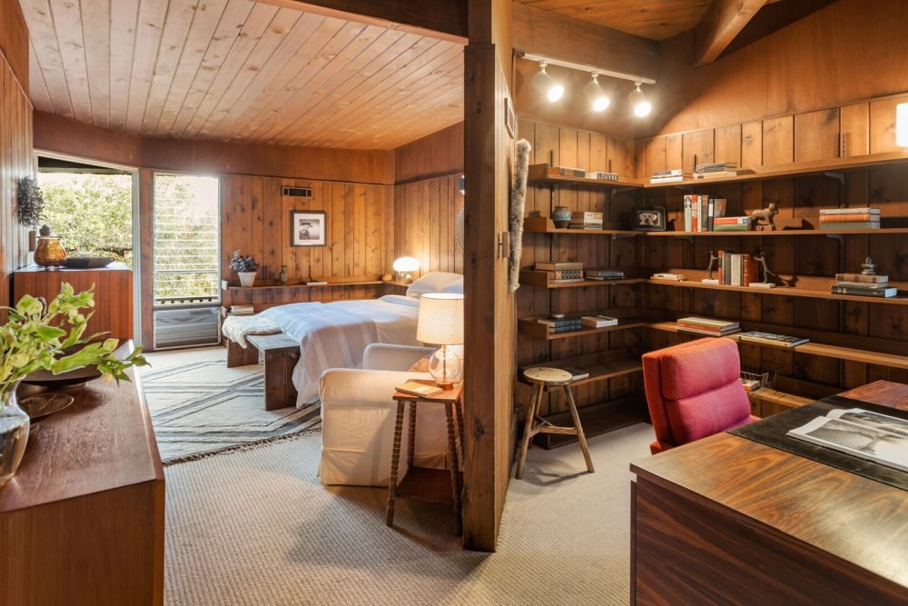 The master bedroom has a private little study nook with a deck and lots of open shelves