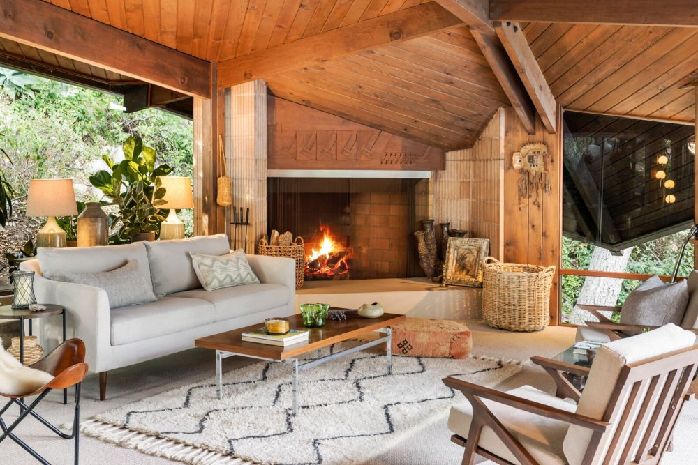 This voersized wood-burning fireplace gives the open-space living area a super cozy feel