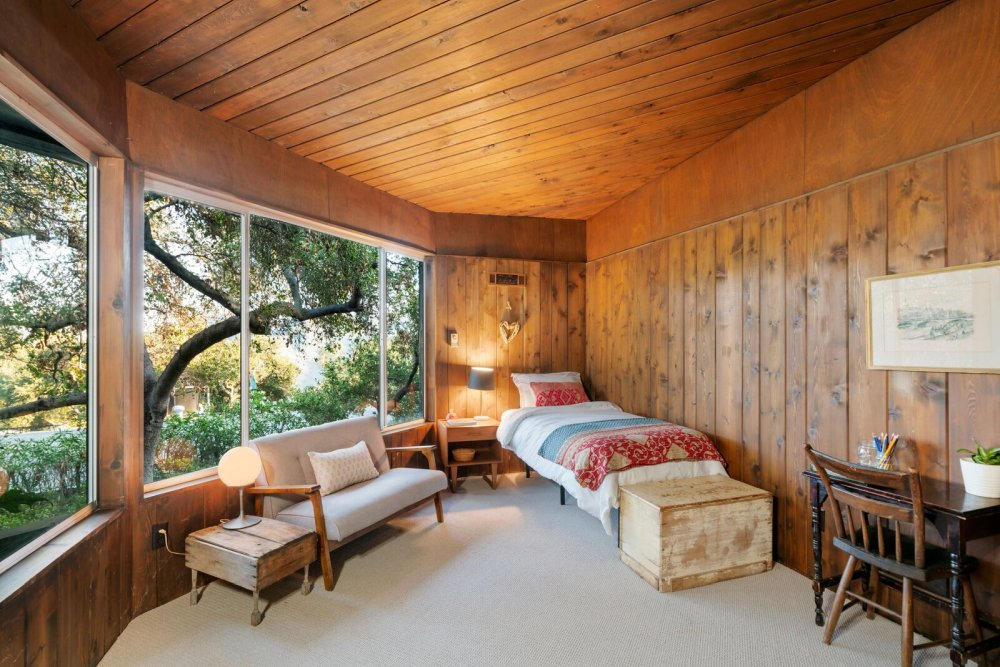 The other two bedrooms are smaller but they enjoy panoramic views of the trees and surrounding landscape
