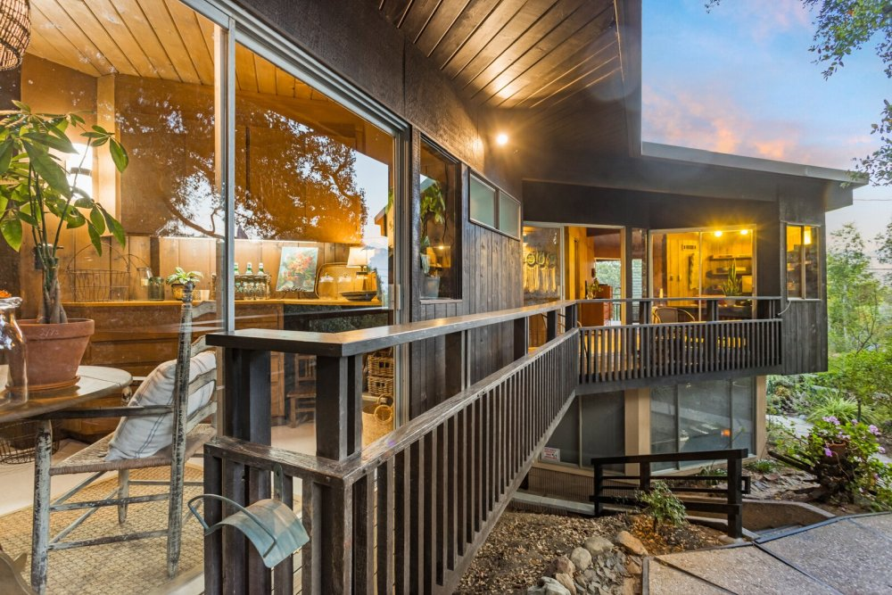 One of the outdoor sitting decks can be accessed from the living area on the upper floor