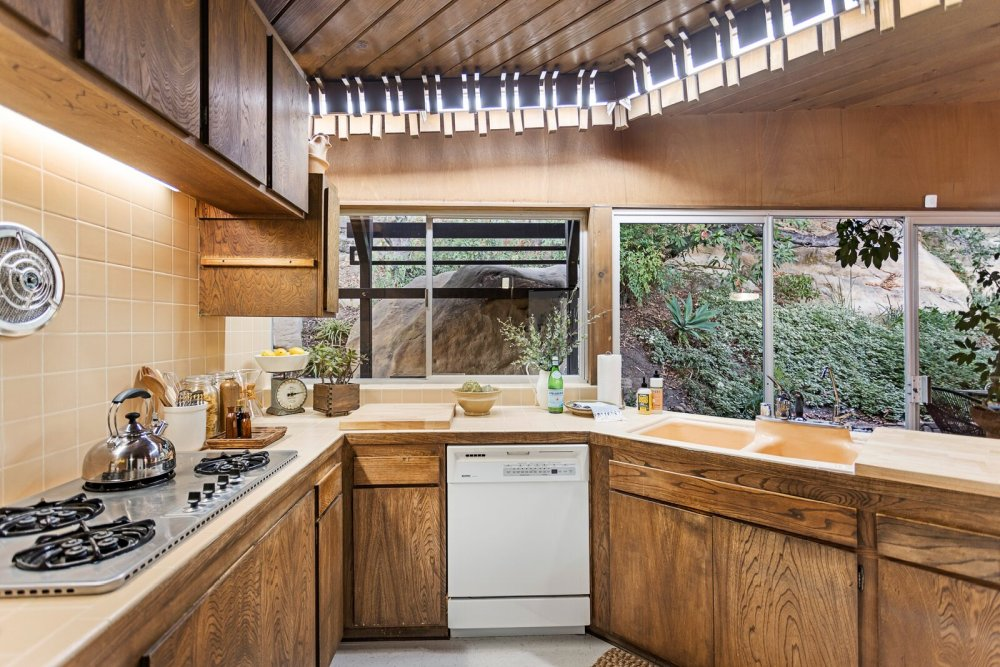 The kitchen gets plenty of natural light and has an inviting geometry