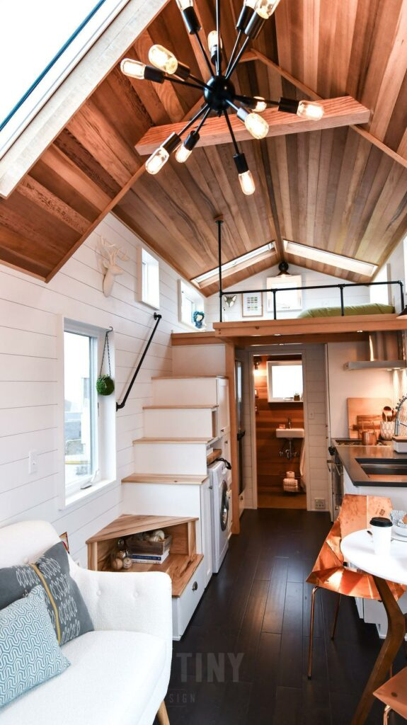 The loft bedroom area can be reached by climbing these stairs with built-in storage