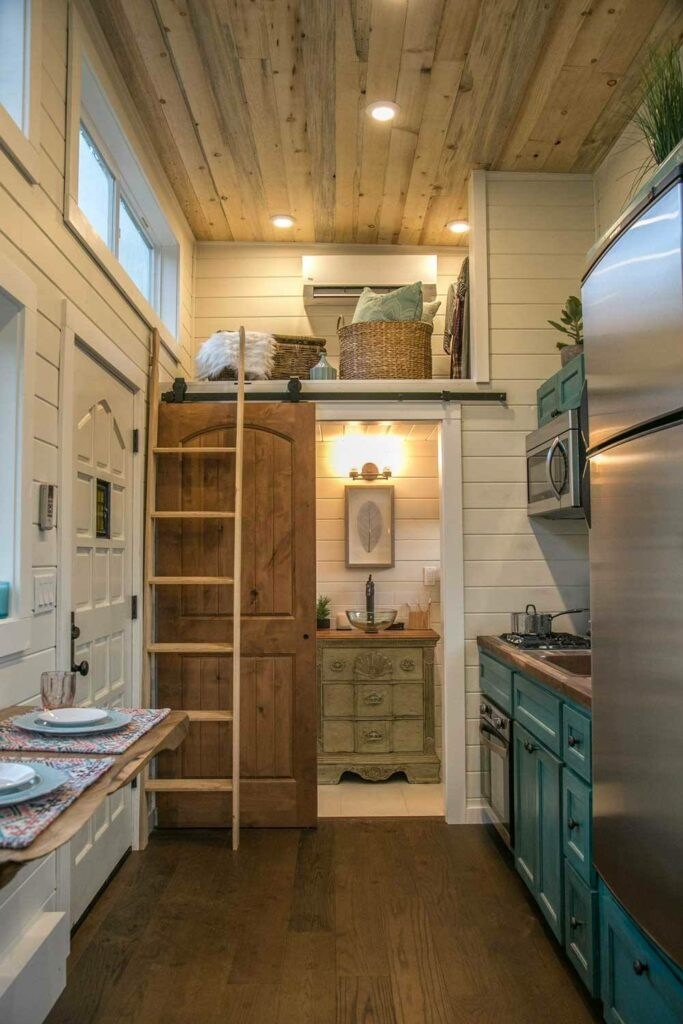 The bathroom is positioned at the back of the house behind a sliding barn door