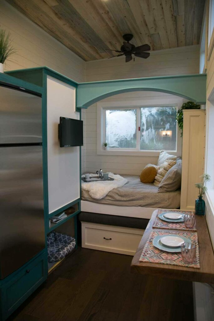 At the other end of the floor plan is a multipurpose seating nook which can also be used as a sleeping area