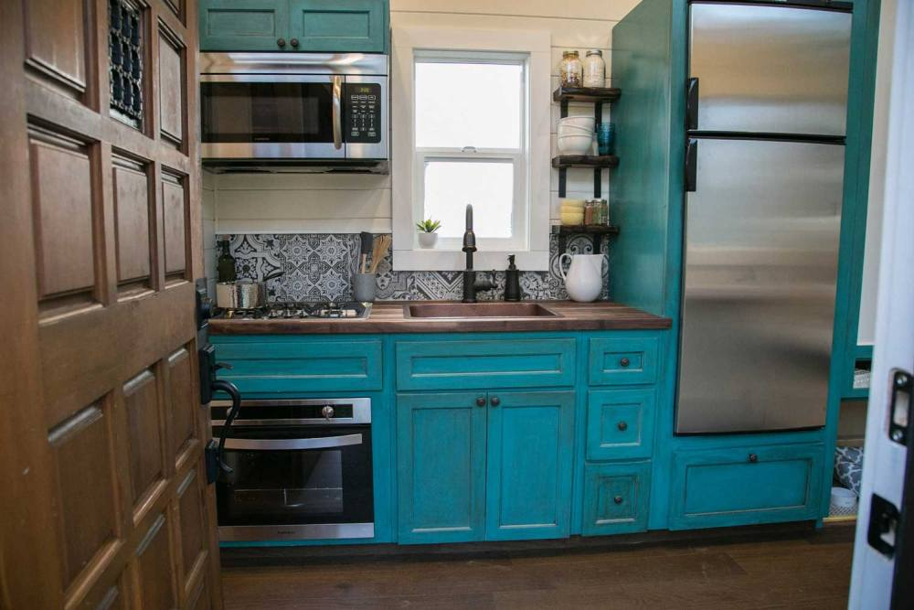 The kitchen is small but fully functional and equipped with all basic appliances