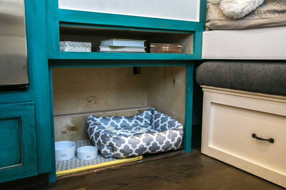 There's even a small open nook at the bottom of this cabinet which can be turned into a pet bed