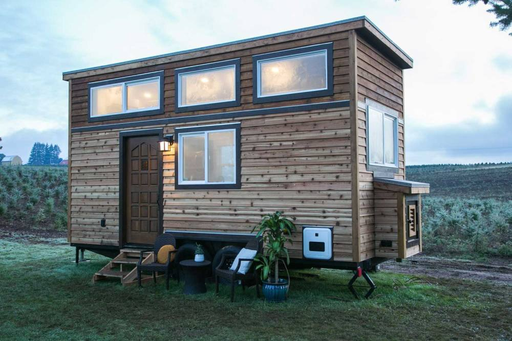 From the outside this tiny house is reminiscent of rustic log cabins