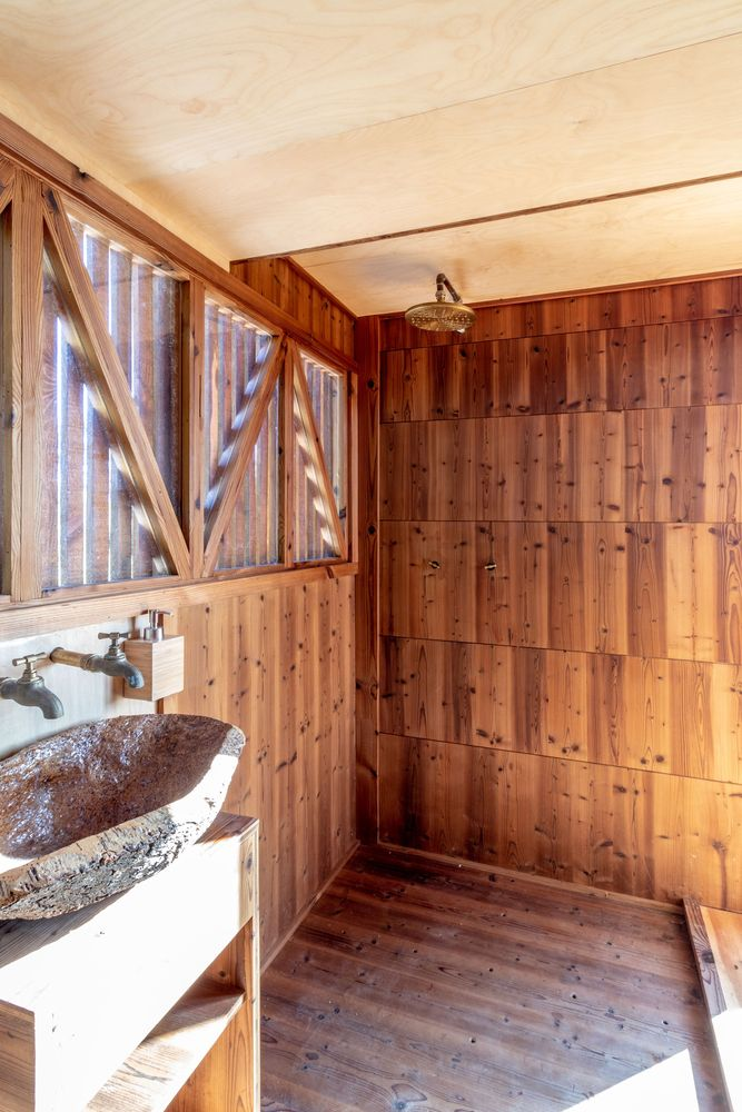 This tiny house has a full bathroom with an open walk-in shower