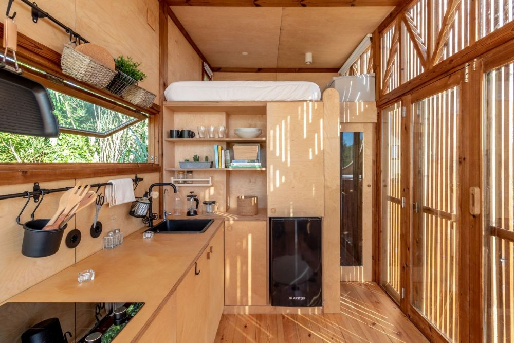 The operable kitchen window brings in sunlight and can also be used for ventilation