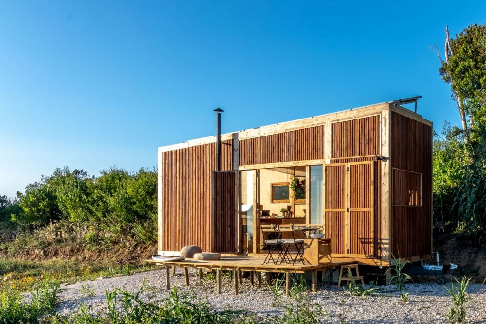 The Ursa house's exterior walls are covered in heat-treated timber