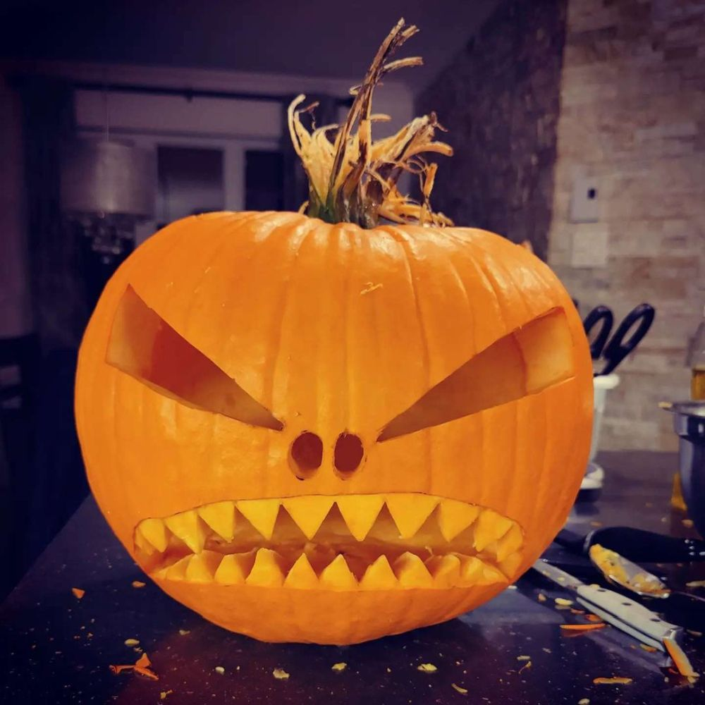 What is the tradition behind carving pumpkins