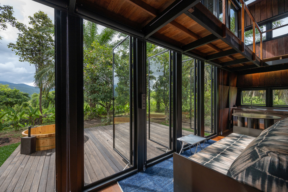 The outline of the mountain range forms the beautiful backdrop for the panoramic view this cabin has
