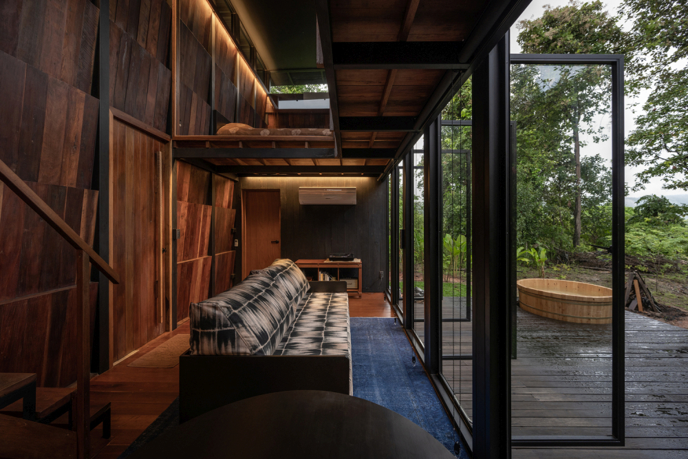 The narrow ground floor is a general social area and a transition space towards the outside world