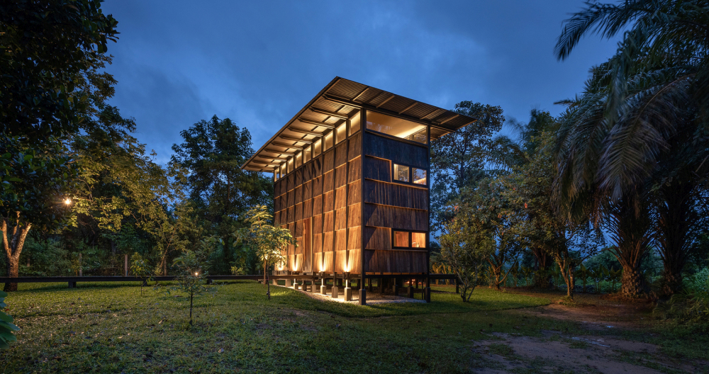 The wood cladding is layered and organized in a grid pattern which adds texture to the flat exterior walls