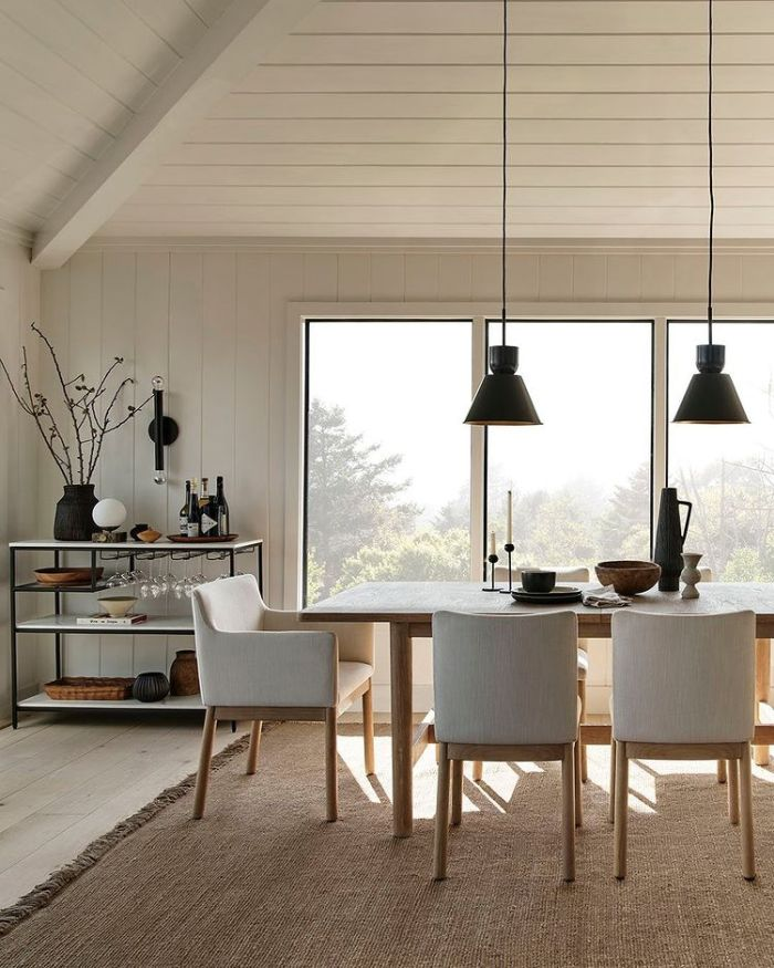 family table with white chairs
