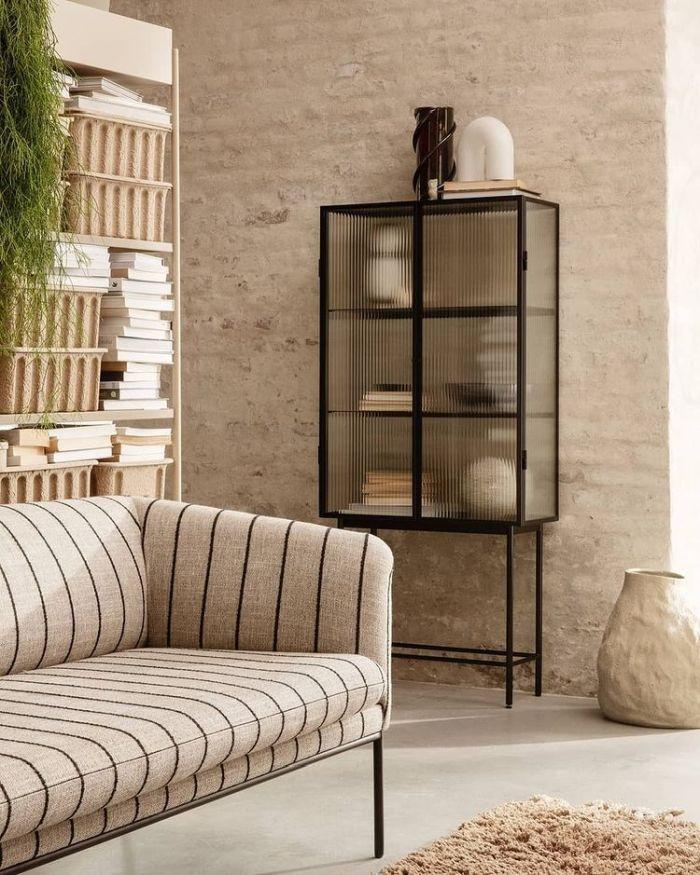 Ferm LIVING - living room with bookshelf and black striped sofa